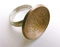Half penny ring set with silver