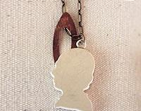 China mans head necklace on brass chain