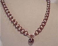Pearl necklace with burgundy beads