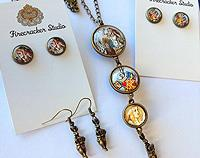 Alice in Wonderland double sided triple drop pendant