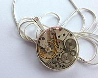 Vintage time piece - silver pendant in silver-plated setting