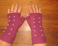 Cranberry fingerless gloves with pearl beads set in small cables.