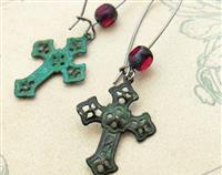 Blood In A Graveyard earrings: distressed verdigris crosses with blood-red glass beads on long ear-wires