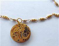 Vintage timepiece rare golden toned watch movement on gold-plated chain