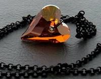 Fiery Heart necklace: sparkly, Swarovski crystal heart pendant in orange-red on matte black chain